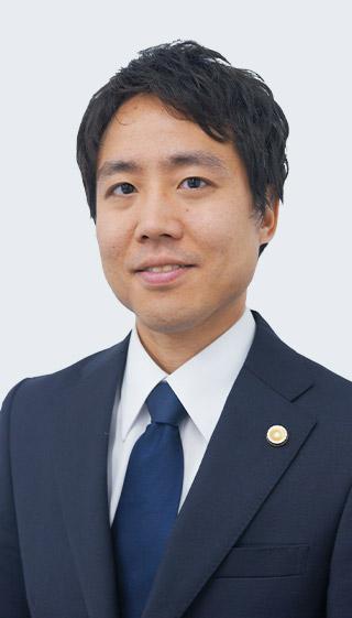 弁護士・岡本 明